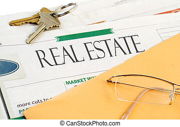 real estate news - real estate section of the newspaper with...