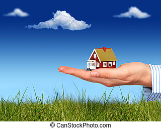 Real estate. - Real estate concept. House in hand.