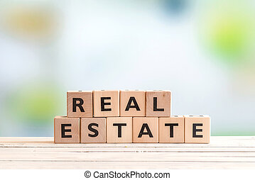 Real estate sign on a wooden table