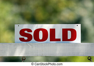 Real Estate Sold - Red on white real estate sold sign