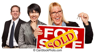 Real Estate Team with Woman Holding Keys and Sold For Sale...