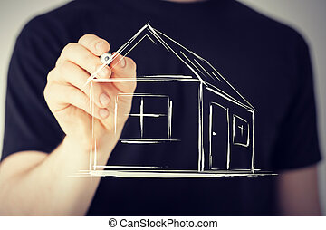 man drawing a house on virtual screen