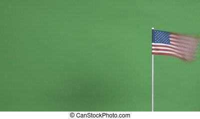 Real flag of the United States waving in the wind and moving...