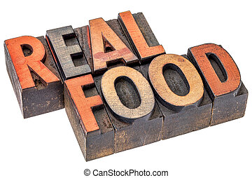 real food word abstract - isolated text in vintage letterpress wood type printing blocks - healthy eating and lifestyle concept