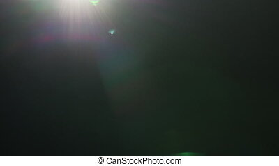 real green lensflare moving through frame for transition or ...