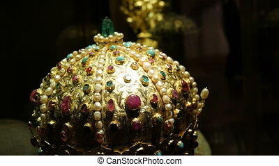 Real old vintage antique royal crown for official coronations, decorated with gold, diamonds, rubies, sapphires and other precious materials