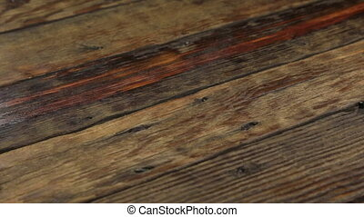 Real old wood texture, vintage dark background. Camera moves...