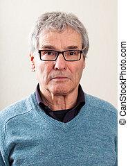 Real People Portrait: Serious Senior Caucasian Man - Plain...