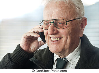 Real people - Senior businessman with phone  portrait