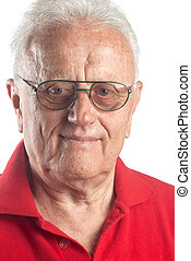 Real people - Studio portrait of smiling senior man wearing...