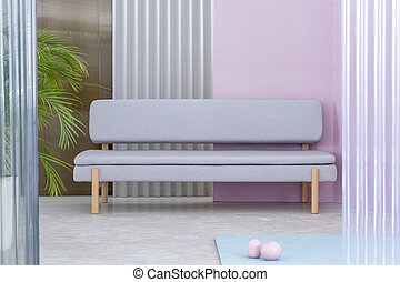 Real photo of a pastel living room interior with a palm next to a gray couch