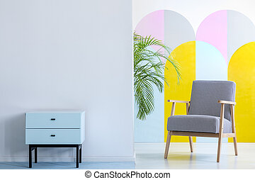 Real photo of a spacious, pastel office interior with mint...