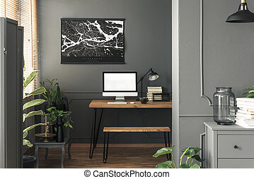 Real photo of dark open space living room interior with map...