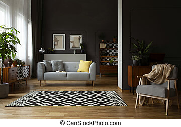 Real photo of open space dark living room interior with...
