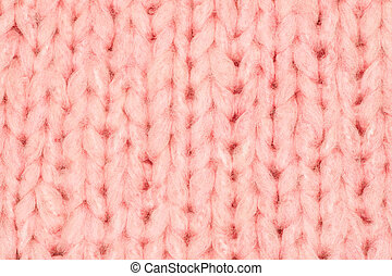 Real pink knit texture. Background, pattern concept. Knitted...