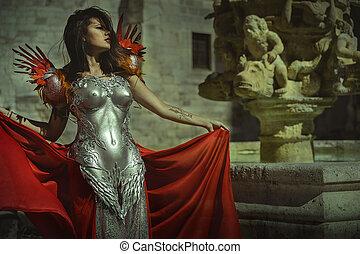 real, reina, en, plata, y, oro, armadura, hermoso, morena, mujer, con, largo, abrigo rojo, y, pelo marrón