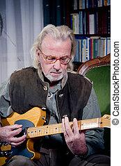 Real rocker  - Elderly man and his guitar