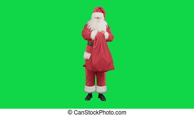 Real Santa Claus carrying big bag full of gifts on a Green Screen Chrome Key