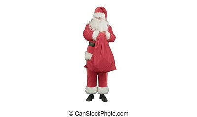 Real Santa Claus carrying big bag full of gifts on white background
