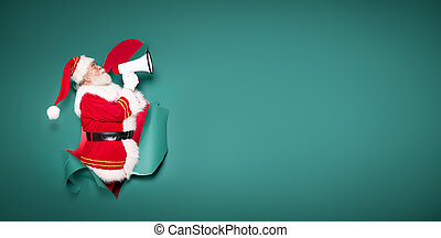 Real Santa Claus screaming through megaphone on a green background.
