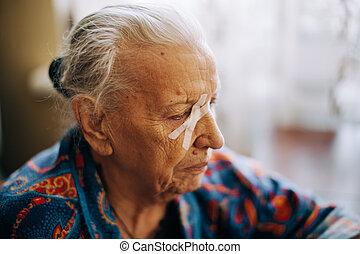 Real senior woman at home in closeup