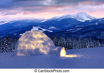 Real snow igloo house in the winter mountains