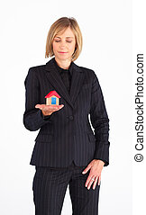 Real state agent holding a house
