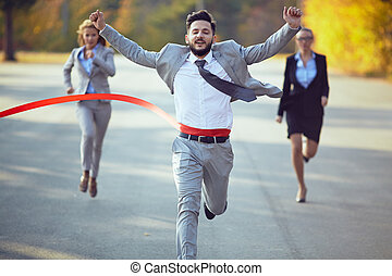 Businessman winning marathon