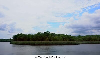 Real time lake sky clouds - blue sky with clouds, lake. Real...