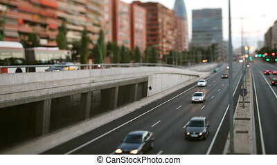 real time panning evening traffic shot from a bridge in barcelona spain, shot with a panomachine for super smooth panning
