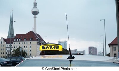 Real time shot of Berlin TV tower with a taxi and a bus