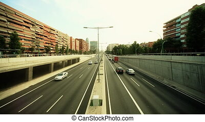 real time super-wide angle evening traffic shot from a bridge in barcelona spain
