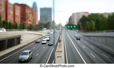 real time tilt and shift evening traffic shot from a bridge in barcelona spain