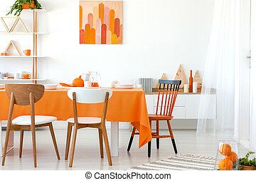 reale, foto, di, tavola cucina, coperto, con, arancia, tovaglia, e, bianco, dishes., grafica, su, parete, e, mensola, in, il, angolo