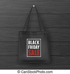 Realistic black textile tote bag with the inscription BLACK...