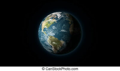 Realistic Earth rotating on a black background. Seamlessly...
