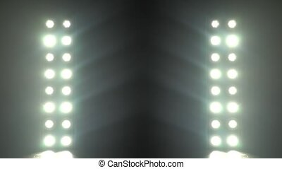 Realistic footage of stage light flashing rays spotlights...