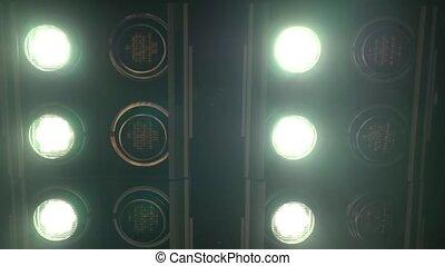 Realistic footage of stage light flashing rays spotlights...