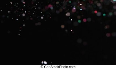 Realistic Glitter Exploding on Black Background.