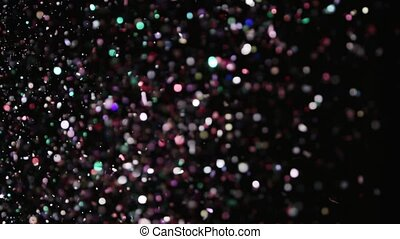 Realistic Glitter Exploding on Black Background. These clips...