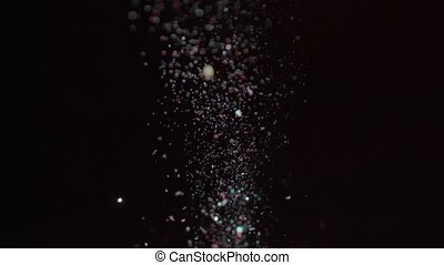 Realistic Glitter Exploding on Black Background.