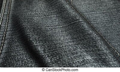 Realistic jeans waving in the wind. Abstract background Ultra-HD resolution. Close-up fabric texture. Seamless loop