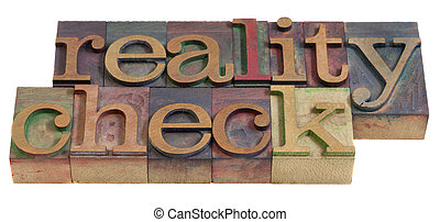 reality check concept - words in vintage wooden letterpress...