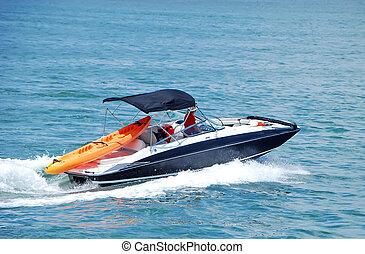 Speedy and sporty motorboat cruising on the florida intercoastal