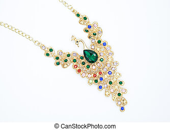 precious necklace in the form of a bird with beautiful green and colourful stones the concept of fashion style