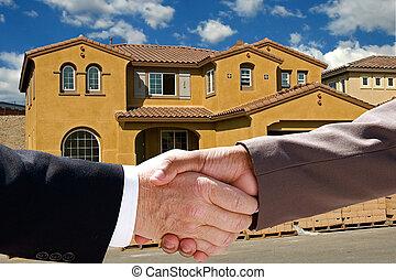 Realtor Closing the Deal - Businessman handshake against the...