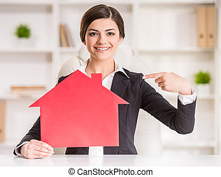 Realtor - Happy realtor woman is showing home for sale sign.