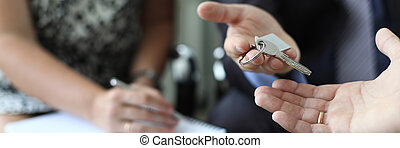 Realtor is handing over key of new apartment