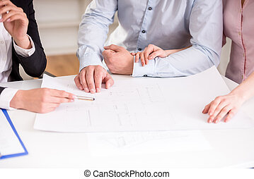 Realtor - Young realtor showing contract with floor layout...