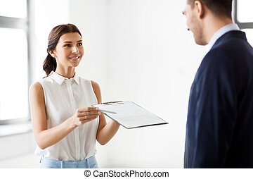realtor showing contract document to customer